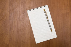 Pen rests on a notepad. Blank sheets. School. Royalty Free Stock Photos