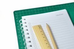 Pen, ruler and notebook Stock Image