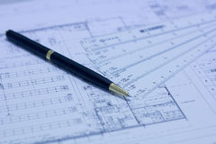 Pen, scale ruler and blueprint Royalty Free Stock Photo