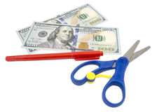 Pen, scissors and dollars Stock Image