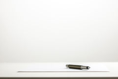 Pen on a sheet of blank white paper Stock Photos
