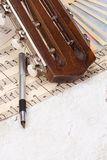 Pen at sheet of music Stock Images