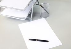 Pen sheet of paper office accessories Royalty Free Stock Photo