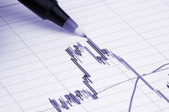 Pen showing diagram. On financial report/magazine Stock Photography