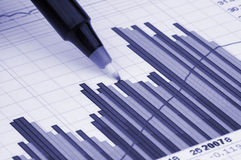 Pen showing diagram. On financial report/magazine Royalty Free Stock Photography