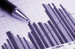 Pen showing diagram. On financial report/magazine Stock Image