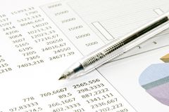Pen showing diagram on report Stock Image