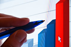 Pen showing financial graph Stock Photo