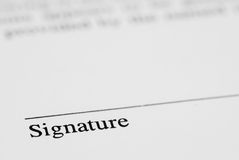 Pen and Signature. A paper ready to be signed with background blur Stock Photography