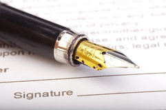 Pen and signature Stock Images