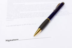 Pen for signature lying on contract paper Stock Photography