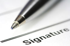 Pen for signature on paper Royalty Free Stock Photos