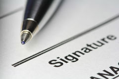 Pen for signature on paper Stock Images