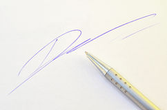 Pen with signature Stock Photos