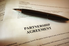 Pen on signatures on a legal document royalty free stock photo