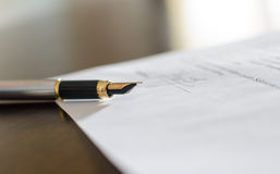 Pen on a signed contract Royalty Free Stock Photography