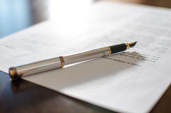 Pen on a signed contract Royalty Free Stock Images