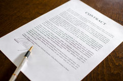 Pen on a signed contract Stock Photography