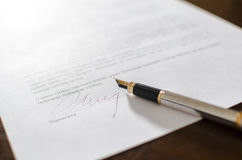 Pen on a signed contract Stock Photos