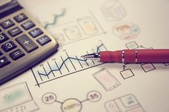 Pen on sketches financial chart and graph, accounting background. Business strategy and financing, budget and investment retro concept Stock Photography