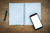 Pen and smartphone and notebook Stock Photography