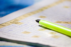 Pen solving crosswords Stock Photos