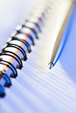 Pen and spiral note-book Stock Images
