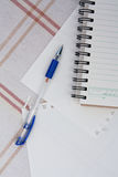 A pen on a spiral notebook. Royalty Free Stock Photography
