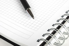 Pen and spiral notebook Stock Images