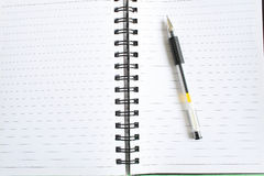 Pen and spiral notebook Royalty Free Stock Photos