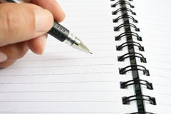 Pen and spiral notebook Stock Photo