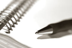 Pen on Spiral Notebook Journal Empty Blank Page royalty free stock photography