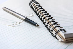 A pen on a spiral notebook. Stock Images