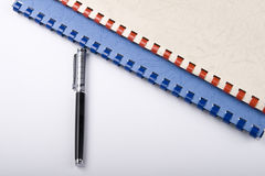 Pen and Spiral Notebooks Stock Photo