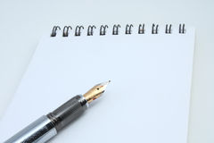 Pen and spiral pad Stock Images