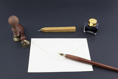 Pen, stamp, envelope, ink pot and wax Royalty Free Stock Images