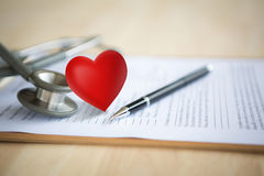 Pen and stethoscope with Heart Stock Image