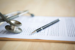 Pen and stethoscope Royalty Free Stock Images
