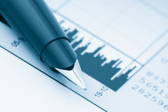 Pen on Stock Chart Stock Photography