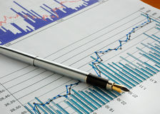 Pen on stock chart Royalty Free Stock Images