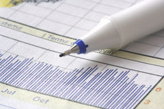 Pen on stock chart Stock Image