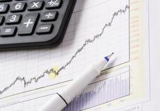 Pen on stock chart on mar 07 Royalty Free Stock Photos