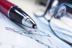 Pen and stock charts Stock Image