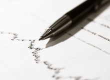 Pen on stock document Royalty Free Stock Images