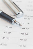 Pen and stock market data chart Royalty Free Stock Images