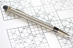 Pen on a sudoku grid. Stock Photo