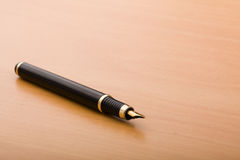 Pen in the table Stock Photography