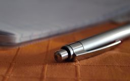 Pen on the table. Royalty Free Stock Photo
