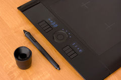 Pen tablet. With pen and penholder on a wooden table Stock Image