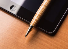 Pen and tablet. A ball point pen and a tablet computer or a smartphone Royalty Free Stock Images